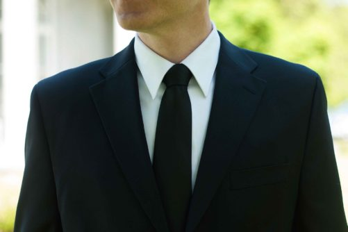 Jet black necktie on groom