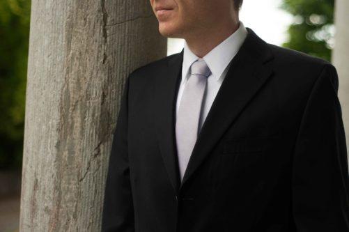 groom in silver necktie